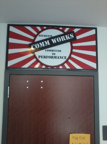 3-dimensional door entrance sign for Students Comm Works club at Monmouth University