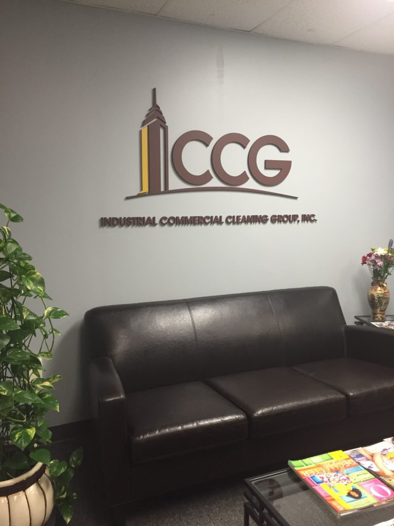 Reception area logo and lettering custom painted to match company branding colors